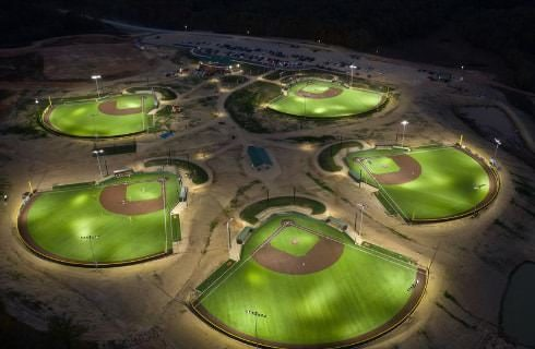 Aerial view of five baseball parks at night